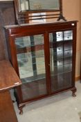 A reproduction mahogany display cabinet having internal glass shelves