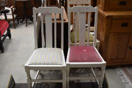 A set of three painted dining chairs, mixed seats