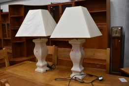 A pair of modern oversized table lamps (one having crack to one side)