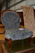 A Victorian ballon back nursing chair on knurl legs , having later upholstery