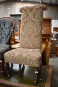 A Victorian prie dieu (prayer) chair, having later upholstery