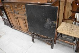 An antique folding card table, top badly damaged, approx 56 x 56cm