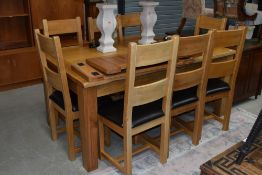 A top quality modern solid golden oak dining table and set of eight matching ladderback chairs,