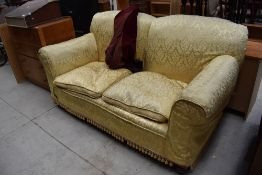 An early 20th Century dropend settee having later damask style loose cover, width approx. 183cm