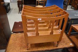 A modern pine wood canterbury style magazine rack