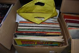 A selection of vinyl records mostly rock and pop interest