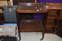 An early 20th Century dark stained oak tea trolley