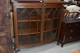 An early 20th Century mahogany display cabinet, on ball and claw feet, width approx. 120cm