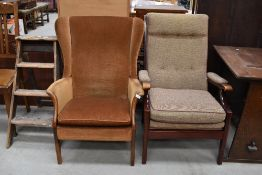 A vintage mustard dralon wing back chair and a modern wood frame armchair