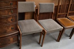 Two vintage upholstered dining chairs