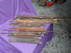A collection of vintage Gun Cleaning Rods with mixed heads and handles, brass fittings, mixed woods,