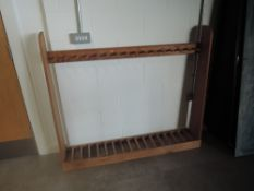 A pine free standing upright Gun Rack, spaces for 17 guns, width 142cm, height 122cm