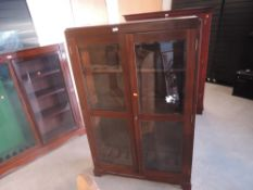 A mahogany and glazed free standing upright Gun Cabinet, spaces for 8 guns, width 96cm, height