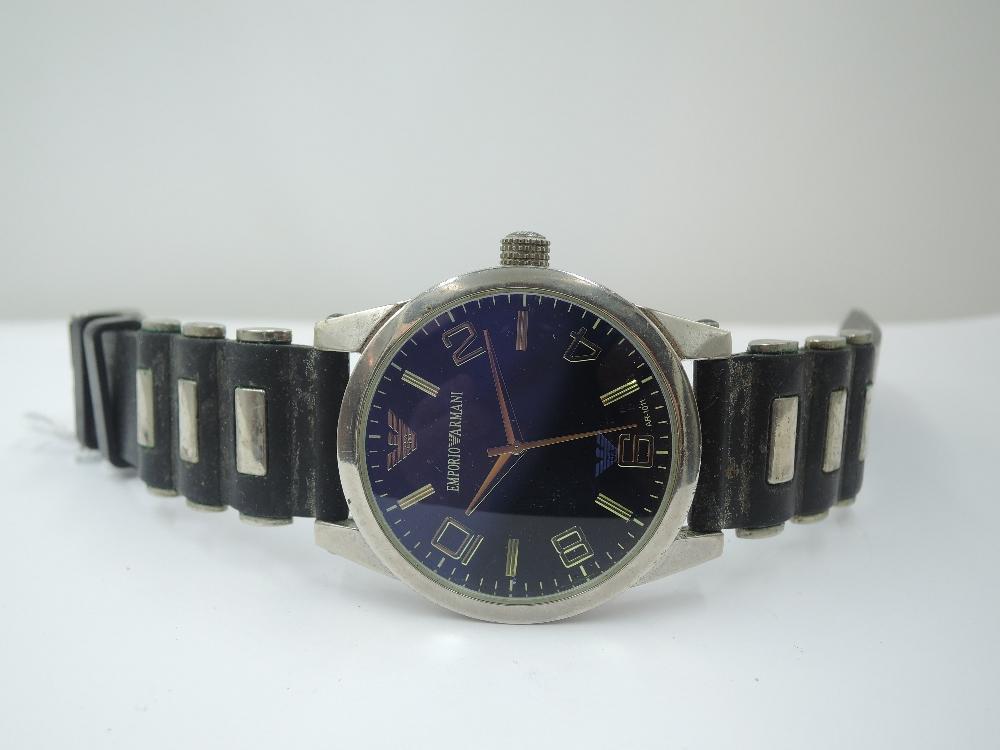 A gent's wrist watch by Emporio Armani, model no: AR-1011 having baton & Arabic numeral dial to blue