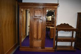 A late Victorian or Edwardian triple wardrobe, two doors being mirrored, possibly later lined,