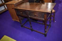 A Priory style oak hall table or dresser base having two frieze drawers , width approx. 107cm