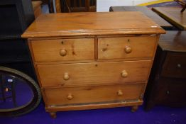 A stripped pine chest of two over two drawers, width approx. 91cm