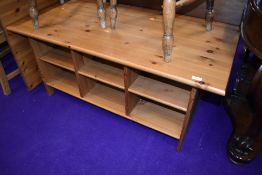 A modern pine coffee table, having under shelves, approx. 120 x 60cm