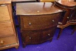 A stained frame bow fronted chest of two deep drawers , width approx. 61cm