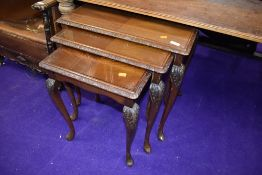 A period style nest of tables, glass insets
