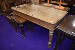 A traditional stripped oak library table on reeded legs, approx. 153 x 77cm, split to top