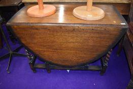 An early to mid 20th Century oak twist gate leg table, width approx. 107cm