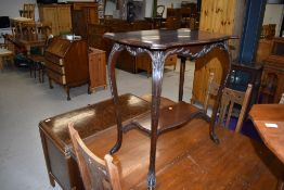 A 1920s mahogany occasional table having shaped top and undertier, width approx. 70cm