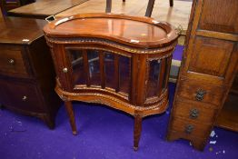 A reproduction display cabinet of kidney shape having tray top, width approx. 73cm
