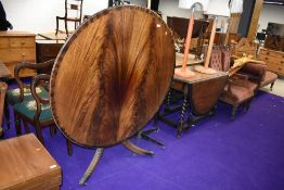 A reproduction Regency fold over circular dining table, diameter approx. 122cm