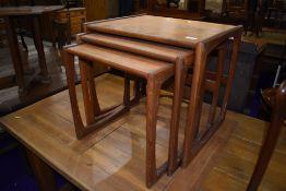 A vintage teak G plan nest of three tables