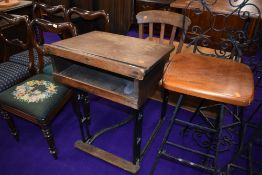 An early 20th Century school desk and chair, oak and cast iron frame