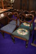 A set of four Victorian balloon back dining chairs
