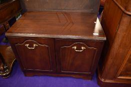 A mahogany effect low cupboard