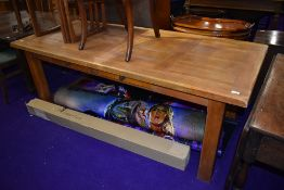 A good quality light stain refectory kitchen dining table with frieze drawers