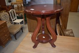 A small wooden plant stand or side table