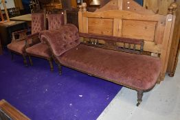 A late Victorian or Edwardian chaise longue and two similar chairs, one having arms