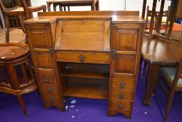 A 1930s oak bureau with side by side cupboards and book shelf under, nice proportions, width approx.