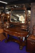 A Victorian style mahogany duchess dressing table, width approx. 122cm