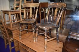 Two traditional solid seat kitchen chairs