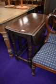 A traditional oak gate leg dining table