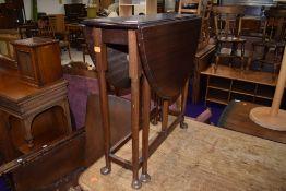 An early 20th Century mahogany narrow gateleg table on cabriole legs
