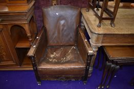 An early 20th Century oak framed armchair with leather upholstery (restoration project)