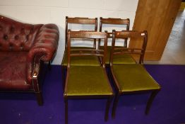 A set of four reproduction Regency rail back dining chairs having inlay to top rails, dralon seats