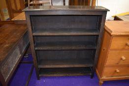A set of dark oak bookshelves, dimensions approx. W92cm H107cm D23cm