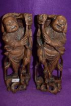 A pair of mirrored hand carved wooden figures of two Chinese fisherman catching Carp approx 30cm