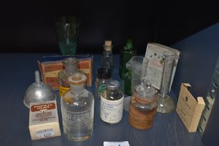 A selection of pharmacy and similar medical bottles and packaging including old labels and etched