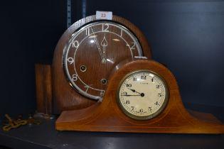 A Naploeon style mantle clock having inlayed veneer case 8 days Swiss made and similar Art Deco