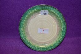 An Art Deco cake plate by Clarice Cliff in a green glaze