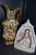 A Staffordshire flat back of reclining Dandy and Majolica styled Ewer