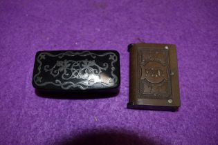 A Victorian papier mache white metal inlayed snuff box and similar pressed vesta case